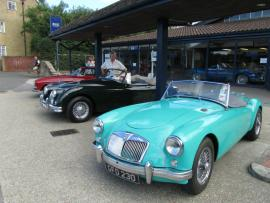 Paul examining Classic Cars for sale in Beaulieu